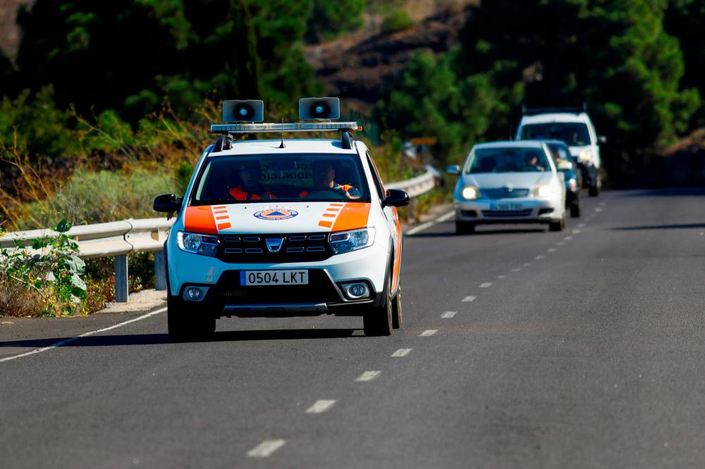 A vehicle with loudspeakers to warn neighbours of an emergency is photographed in El Paso, on the Canary Island of La Palma, Spain, September 19, 2021. REUTERSpix