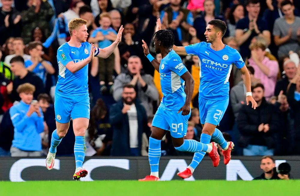 Manchester City's Belgian midfielder Kevin De Bruyne celebrates scoring his team's first goal during the English League Cup third round football match between Manchester City and Wycombe Wanderers – AFPPIX