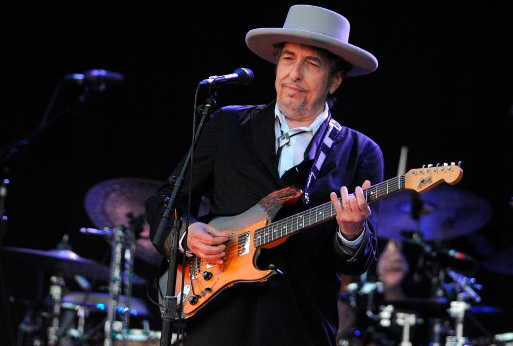 (FILES) In this file photo taken on July 22, 2012 US legend Bob Dylan performs on stage during the 21st edition of the Vieilles Charrues music festival in Carhaix-Plouguer, western France. -AFP