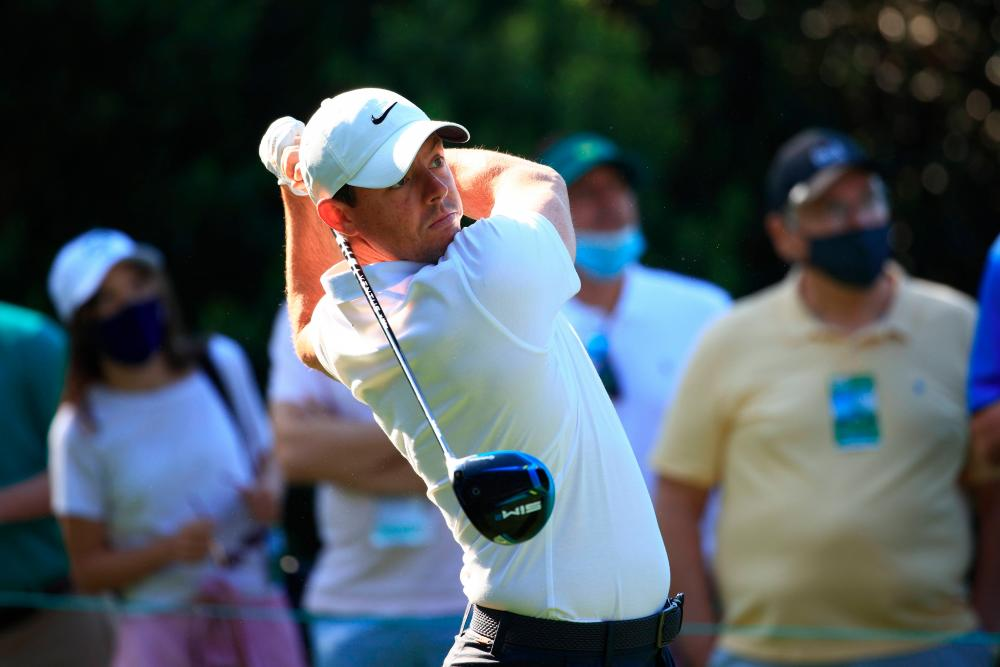 McIlroy plays his shot from the 15th tee during a practice round prior to the Masters at Augusta National Golf Club. – AFPPIX