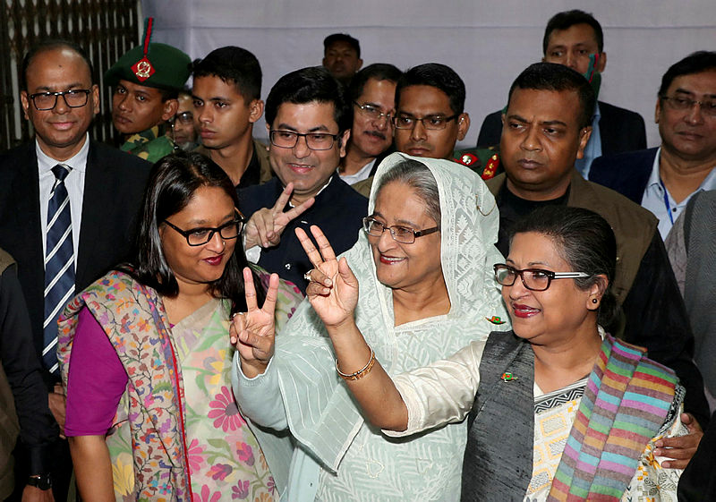 Prime Minister Sheikh Hasina gestures after casting her vote in the morning during the general election in Dhaka, Bangladesh, Dec 30, 2018. — AFP