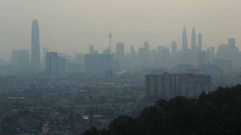 A view of the Kuala Lumpur skyline shrouded by haze on Aug 1, 2019. — BBX