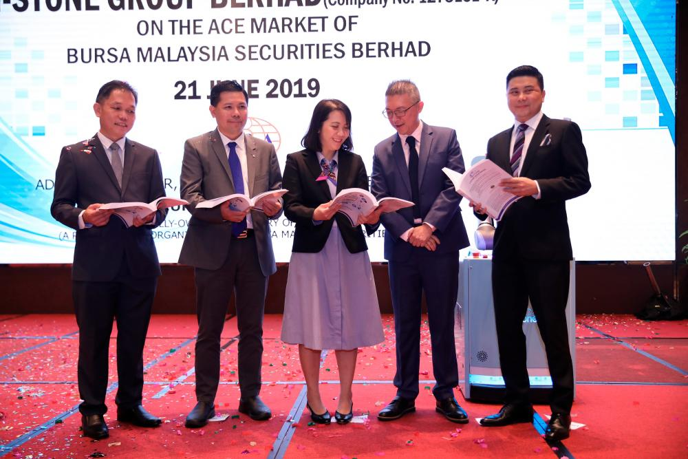 From left: i-Stone Group Bhd executive directors Chin Chung Lek and Chan Kok San, Tee, M&A Securities Sdn Bhd head of corporate finance Gary Ting Hua Tai and managing director of corporate finance Datuk Bill Tan at the prospectus launch.