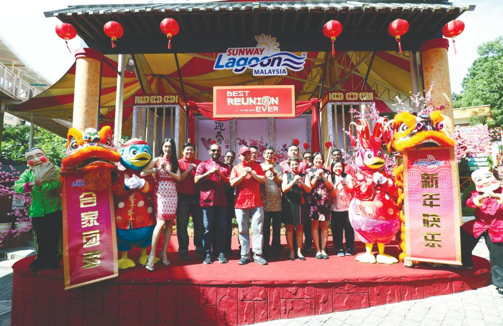 At the launch ... (clockwise, from top) Chia (far left) and Choo (with cap) with Sunway team wishing all Gong Xi Fa Cai– Asyraf Rasid/thesun