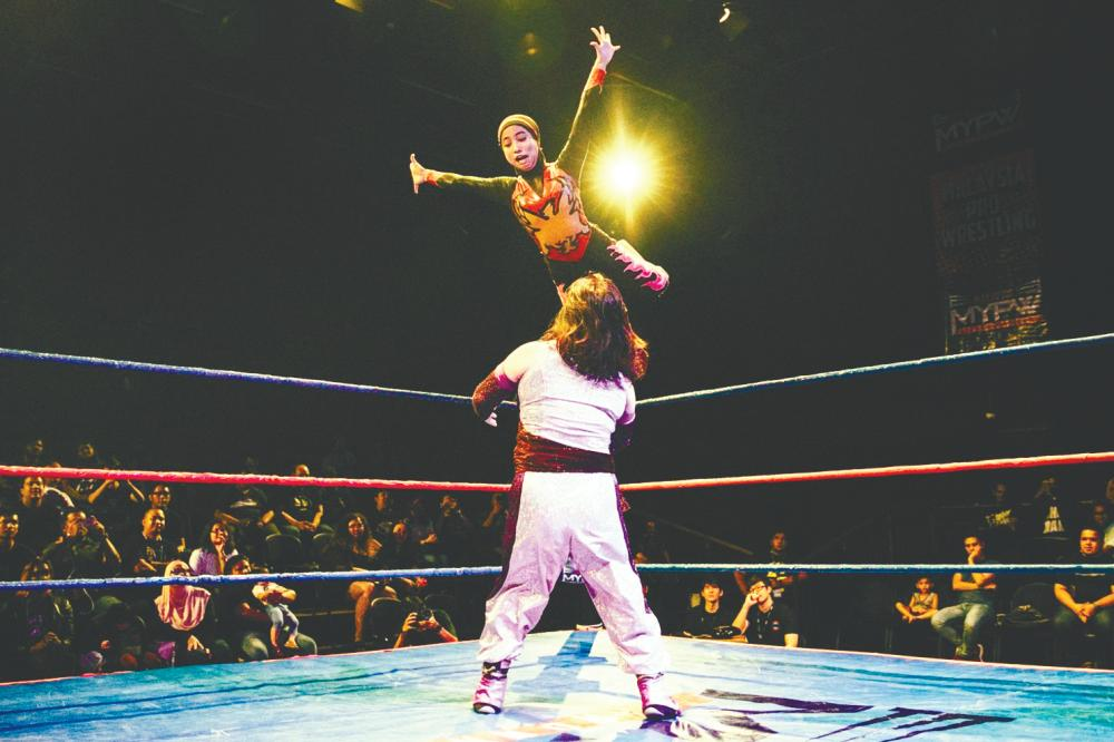 Phoenix takes flight during one of her pro matches. - Calvin Alexi