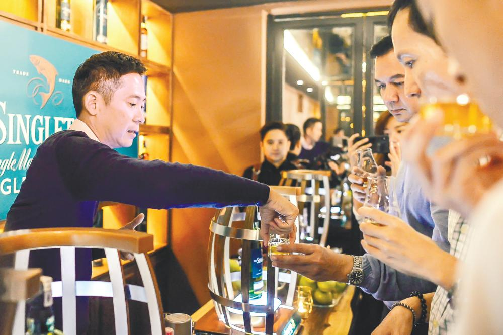 Jeremy Lee (left) guided the guests through an exclusive whisky tasting event.