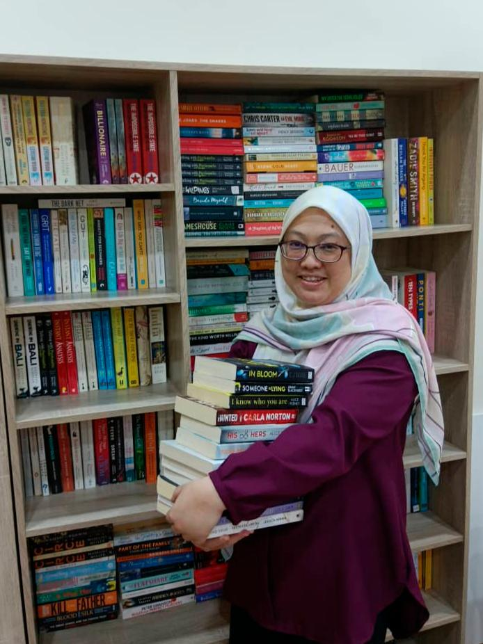 Noreen with some of the books she has for sale. – Wan Noreen Wan Ahmad