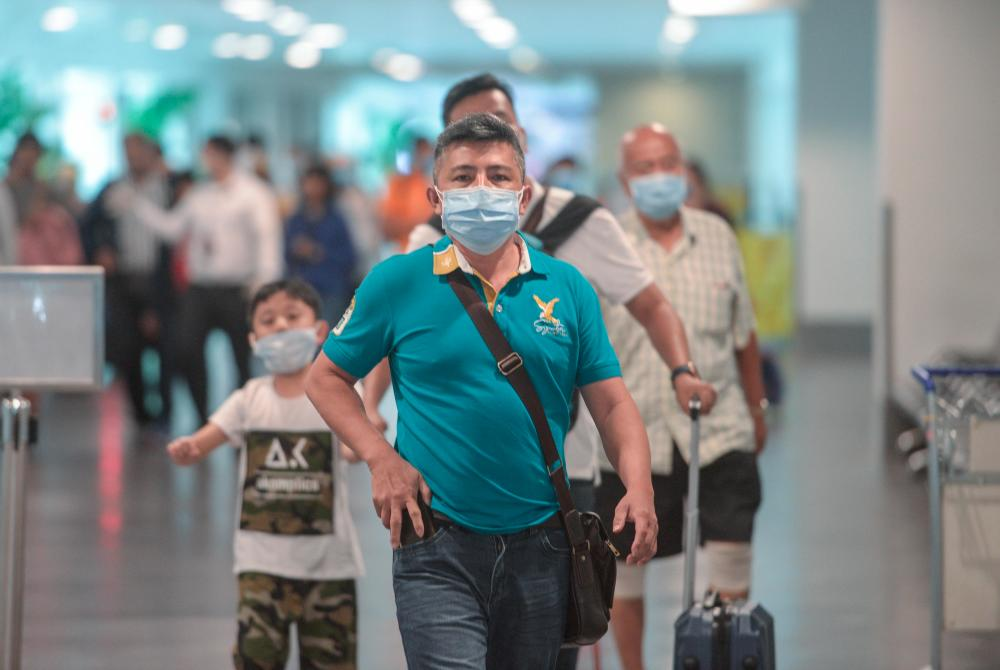 A group of tourists believed to be from China used mouthwash and nose masks to prevent 2019 Novel Coronavirus (2019-nCoV) infections during surveys at the Kuala Lumpur International Airport (KLIA) and KLIA2 on Jan 29. — Sunpix by Amirul Syafiq Mohd Din