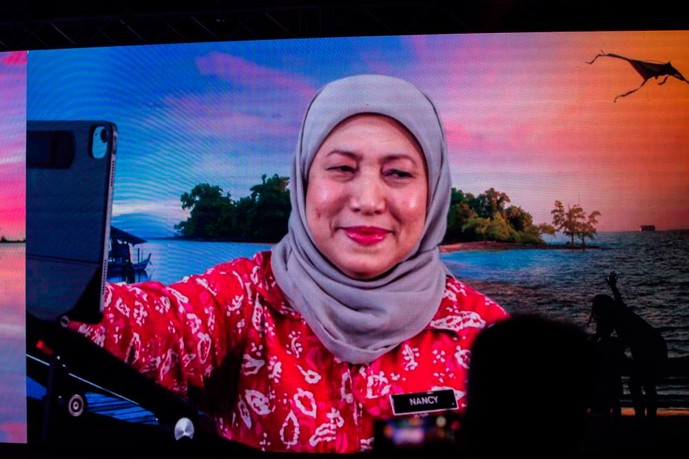 Tourism, Arts and Culture Minister Datuk Seri Nancy Shukri officiating the ITB Berlin Now 2021 (Malaysia Chapter) ceremony through video conference in a hotel today. — Bernama
