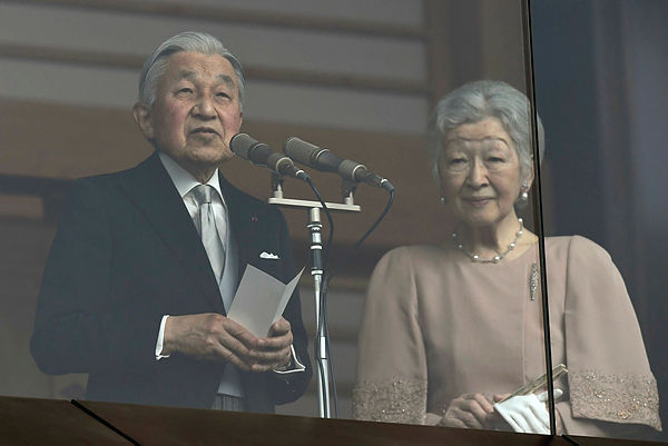 Japan's Emperor Akihito delivers a speech while greeting wellwishers on his birthday beside Empress Michiko at the Imperial Palace on Dec 23, 2018. — AFP