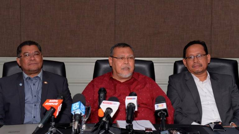 Johor PH has appointed state Amanah chairman Aminolhuda Hassan (C) during a press conference on Feb 26, 2020. — Bernama