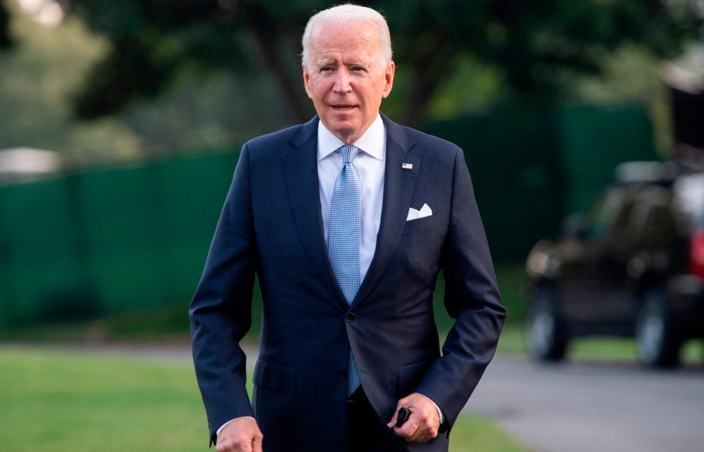 US President Joe Biden walks to Marine One prior to departure from the South Lawn of the White House in Washington, DC, July 29, 2021, as he travels to Walter Reed National Military Medical Center in Maryland where First Lady Jill Biden is having a medical procedure. -AFP