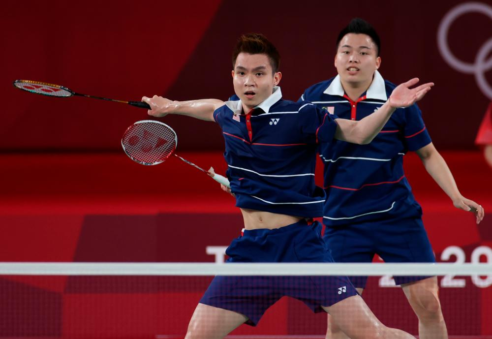 Aaron Chia(behind) and Soh Wooi Yik (front) against Indonesian Mohammad Ahsan and Hendra Setiawan in the third and fourth place match at the Tokyo 2020 Olympic Games at Mushashino Sports Plaza. – BERNAMAPIX