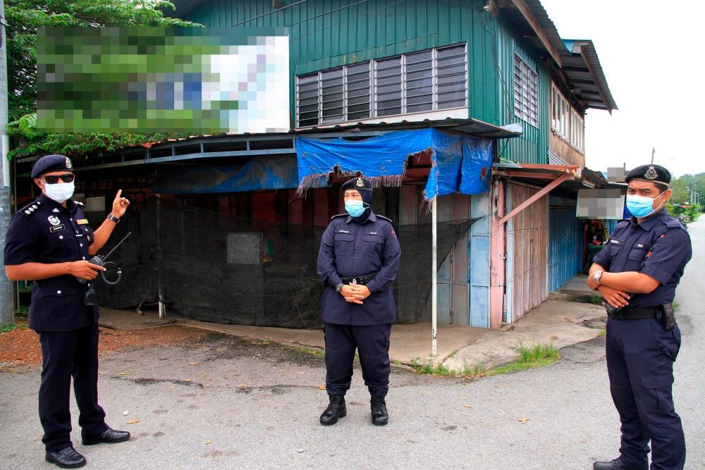 Police guard a premises a Covid-19 hotspot in Kubang Pasu, on July 29, 2020. — Bernama