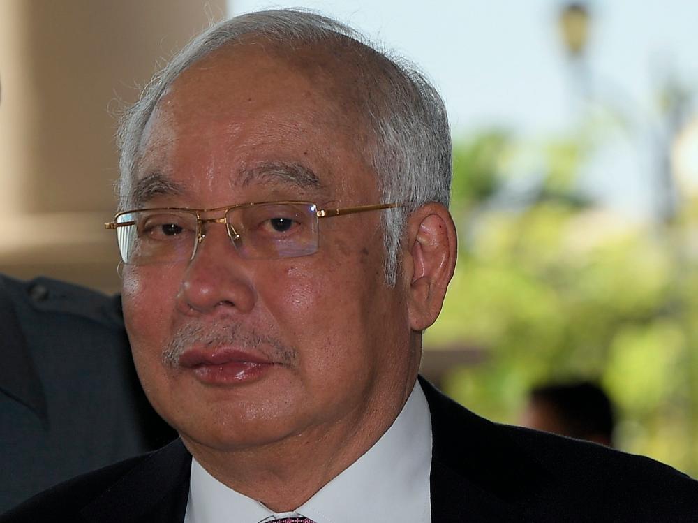 Former prime minister Datuk Seri Najib Abdul Razak appears at the Kuala Lumpur Court Complex today. - Bernama