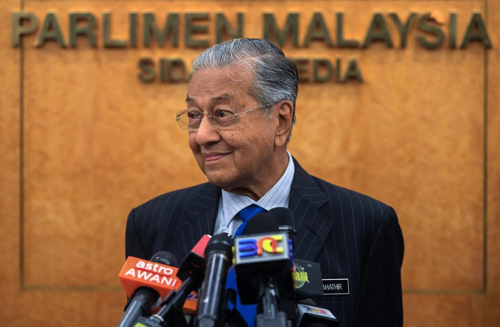 Prime Minister Tun Dr Mahathir Mohamad speaks at a press conference at Parliament today - Bernama