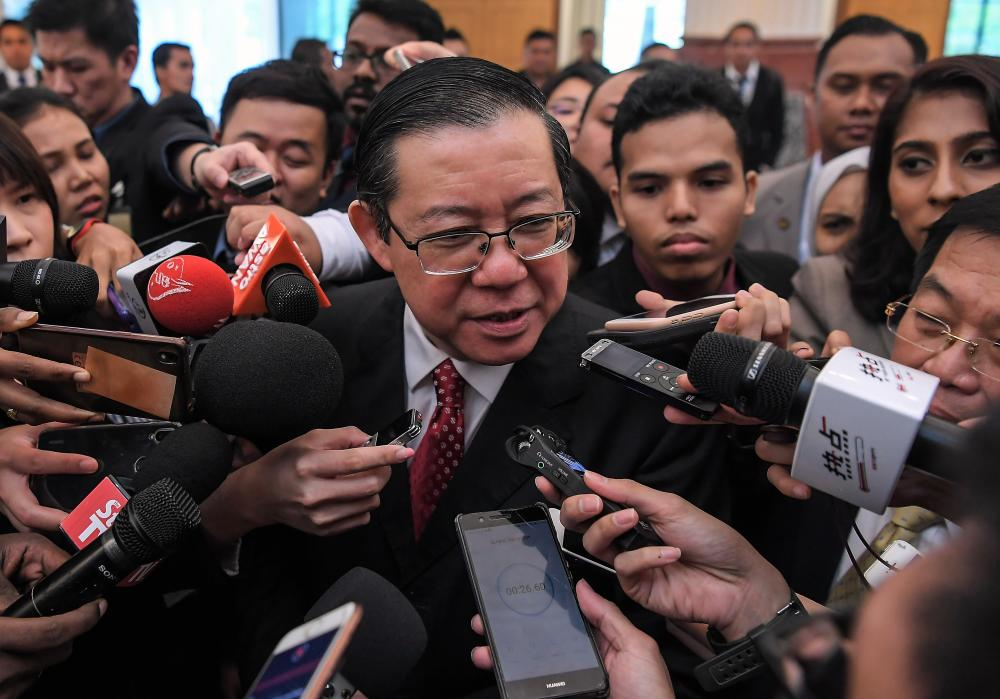 Finance Minister Lim Guan Eng is interviewed by the media at Parliament today. - Bernama