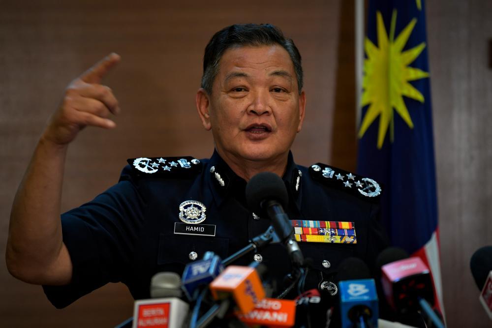 Inspector-General of Police Tan Sri Abdul Hamid Bador during press conference regarding current issues at Bukit Aman yesterday. — Bernama