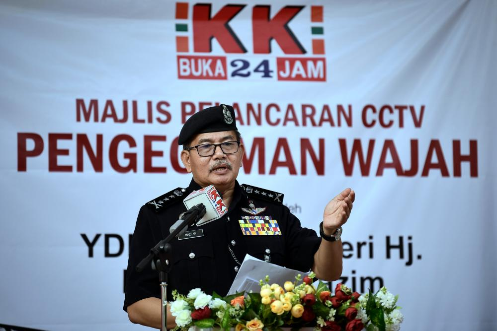 Kuala Lumpur Police chief Datuk Seri Mazlan Lazim talks at the launch of the facial recognition CCTV system at KK Mart, Taman Desa Petaling yesterday. — Bernama