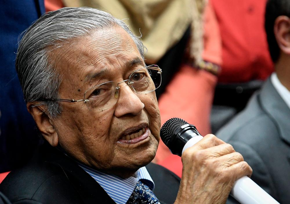 Prime Minister Tun Dr Mahathir Mohamad speaks during a press conference after chairing the PPBM (Bersatu) Supreme Council Meeting at the PPBM headquarters, here today. - Bernama