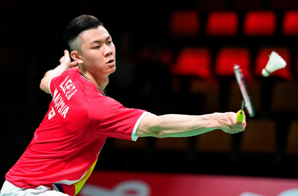 Malaysia's Jia Lee Zii competes with Japan's Kento Momota (unseen) during a men's single match in the Thomas Cup men's team Badminton match between Japan and Malaysia in in Aarhus, Denmark, on October 14, 2021. AFPpix