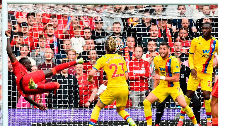 Liverpool's Sadio Mane (left) shoots at goal against Crystal Palace at Anfield. – REUTERSPIX