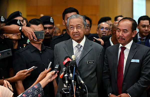 Prime Minister Tun Dr Mahathir Mohamad speaks to the media after attending a closed briefing with the leaders of statutory bodies in Putrajaya on Jan 28, 2019. — Bernama