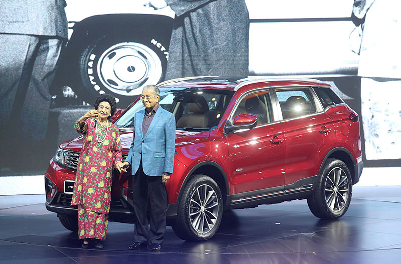 Prime Minister Tun Dr Mahathir Mohamad and Tun Dr. Siti Hasmah pose for a photograph with the brand new Proton X70. — Sunpix by Asyraf Rasid