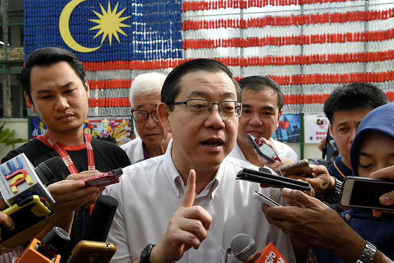 Finance Minister Lim Guan Eng talks to the media after officiating the giant Jalur Gemilang made out of 2,002 bottles of mineral water by the pupils of SRJK (C) Chung Hwa Pusat, Butterworth on Aug 25, 2019. — Bernama