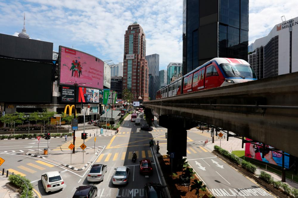 A general view shows increasingly busy streets as Malaysia reopens a majority of businesses, after a movement control order was imposed to fight the outbreak of the coronavirus disease (Covid-19), in Kuala Lumpur, Malaysia May 4, 2020. - Reuters
