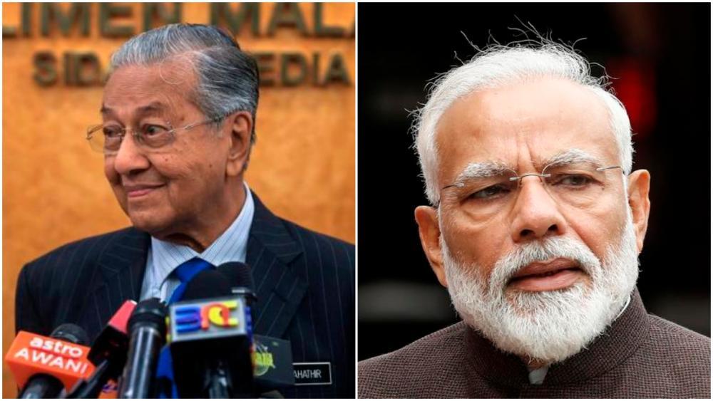 Mahathir (L) and Modi.