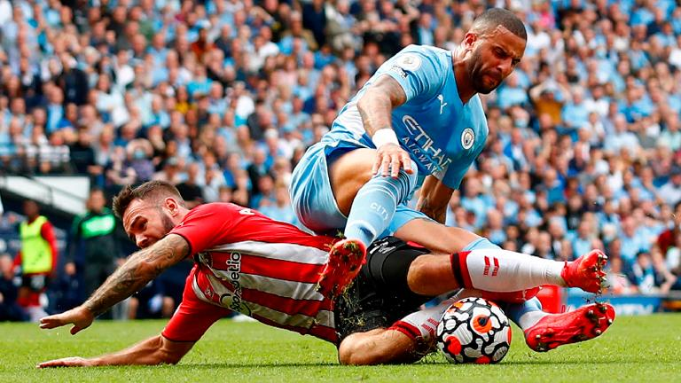Southampton's Adam Armstrong (left) is fouled by Manchester City's Kyle Walker and wins a penalty that is later overturned by VAR. – REUTERSPIX