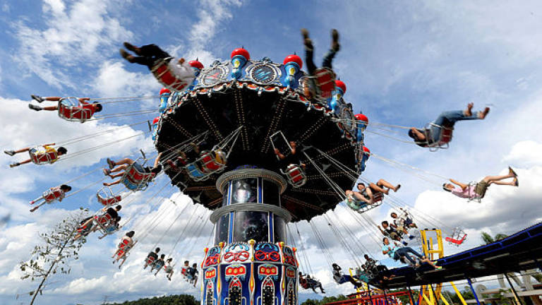 Filepix showing visitors taking part in the 'HyperSpin' ride during the opening of the Movie Animation Park Studios, in Ipoh on June 26, 2017 — Bernama
