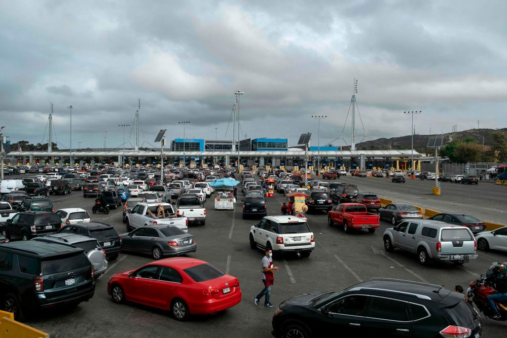 This file photo taken on August 20, 2021 shows a view of the San Ysidro crossing port on the Mexican side of the US-Mexico border in Tijuana, Baja Caifornia state. AFPpix
