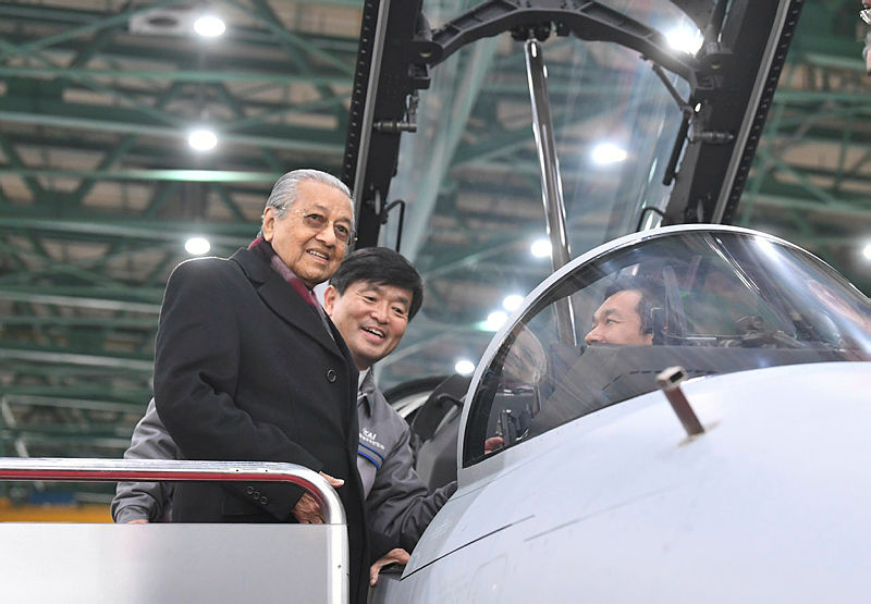 Prime Minister Tun Dr Mahathir Mohamad, with representatives from Korea Aerospace Industries (KAI), as he checks out the FA-50 Fighting Eagle light combat aircraft (LCA), on Nov 25, 2019. — Bernama
