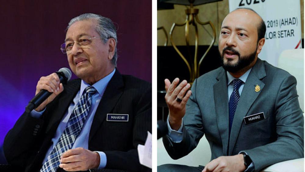 Prime Minister Tun Dr Mahathir Mohamad (left) and his son Datuk Seri Mukhriz Mahathir.