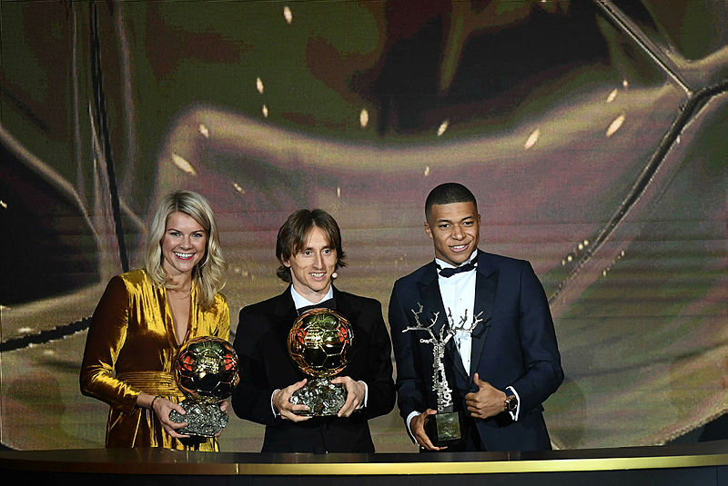 2018 FIFA Ballon d'Or winner Luka Modric, Women's Ballon d'Or winner Ada Hegerberg and Under-21 Ballon d'Or (Kopa trophy) winner Kylian Mbappe pose at the end of the 2018 FIFA Ballon d'Or award ceremony at the Grand Palais in Paris on Dec 3, 2018. — AFP