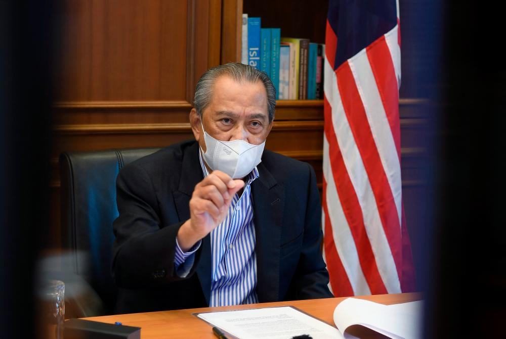 Prime Minister Tan Sri Muhyiddin Yassin speaking during a virtual press conference on developments during the government's fight against the Covid-19 pandemic at his office today. — Bernama