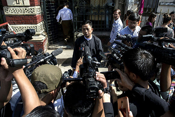 Than Zaw Aung (C), lawyer of jailed Myanmar journalists Wa Lone and Kyaw Soe Oo speaks to journalists after a hearing at the High Court in Yangon on Dec 24, 2018. — AFP