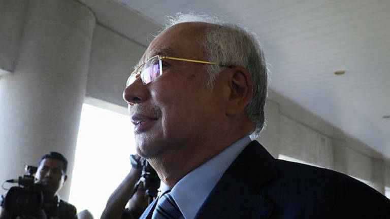 Former prime minister Datuk Seri Najib Abdul Razak walks out of a courtroom for a break at Kuala Lumpur High Court on Jan 6, 2020. — Reuters