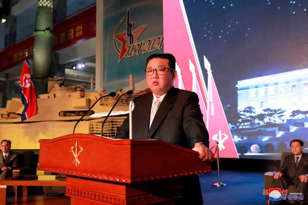 """This picture taken on October 11, 2021 and released from North Korea's official Korean Central News Agency (KCNA) on October 12 shows North Korean leader Kim Jong Un giving a speech during the opening ceremony of The Defence Development Exhibition """"Self-Defence-2021"""" in Pyongyang. AFPpix"""