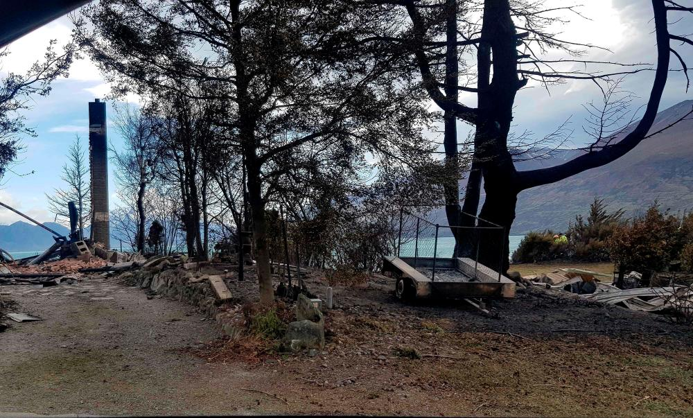 This handout photo taken on October 6, 2020 courtesy of Gary Kircher shows damage caused by the South Island wildfires in Lake Ohau. — AFP