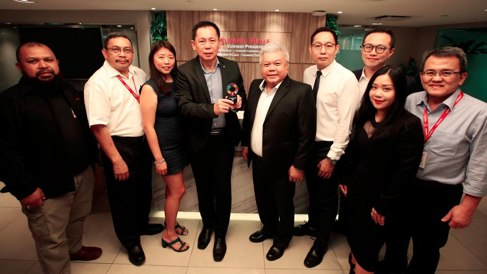 Sunway Malls & Theme Park CEO HC Chan (fourth from left) and (on his left) Sunway Malls COO Kevin Tann, with the team supporting the project.
