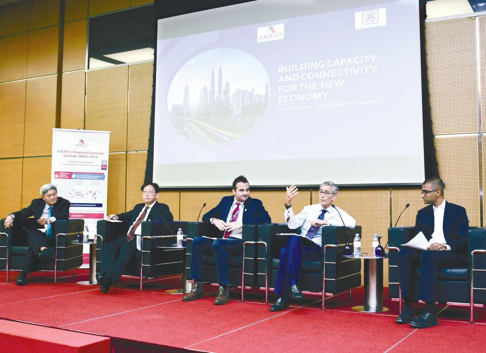 Malaysian Economic Association deputy president Prof Dr Yeah Kim Leng (left), who is the moderator, together with panelists (from left) Khor, World Bank lead economist, macroeconomics, trade and investment global practice Dr Richard Record, Hanna and Digi Telecommunications chief digital officer Praveen Rajan during the briefing. – BERNAMAPIX