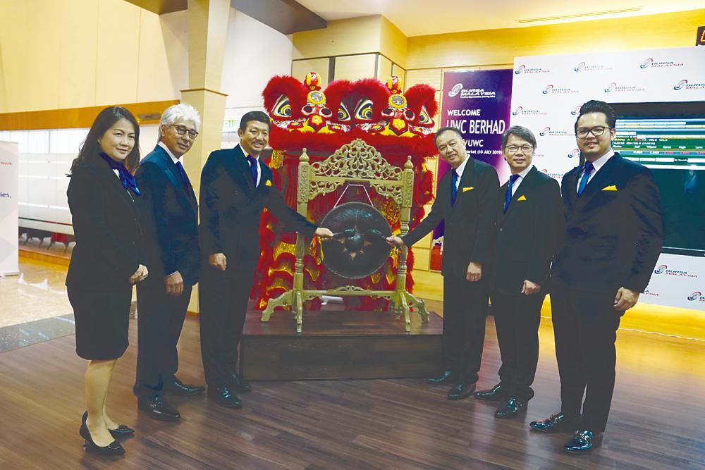From left: Independent non-executive director F'ng Meow Cheng, independent non-executive chairman Datuk Wan Hashim Wan Jusoh, Ng, executive director/group COO Lau Chee Kheong, independent non-executive director Lio Chee Yeong, and head of corporate affairs and communications Ng Chin Liang at the listing ceremony yesterday.
