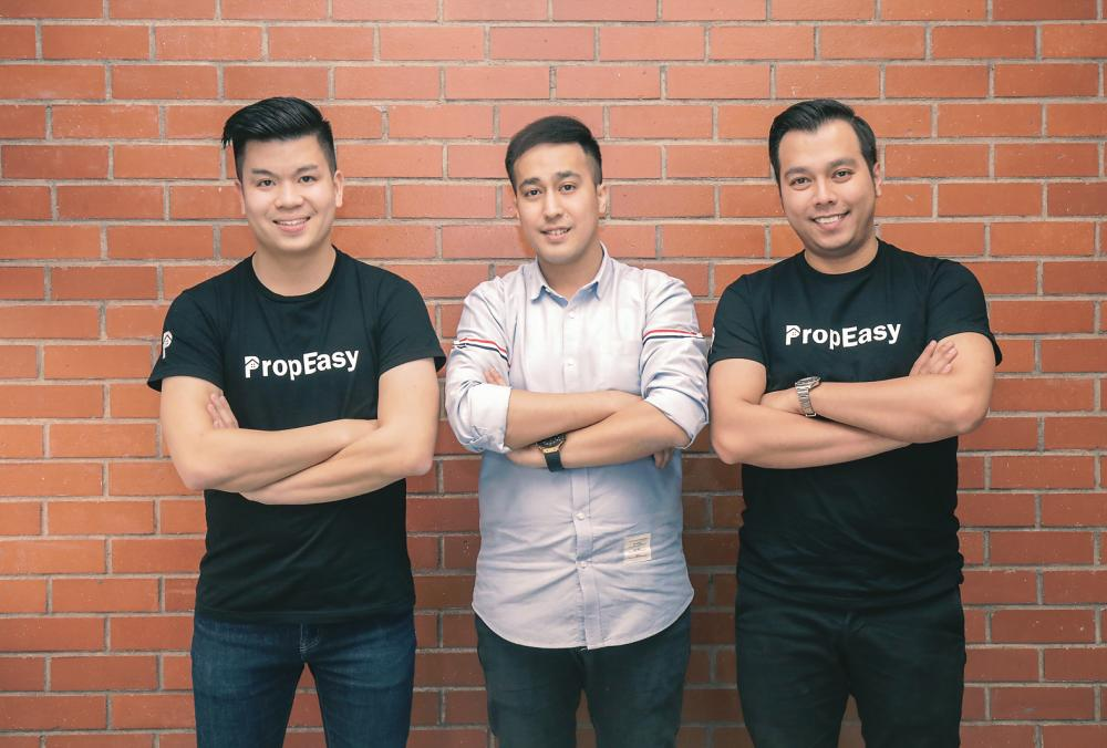 Tan (left) and his team members including Loke (centre).