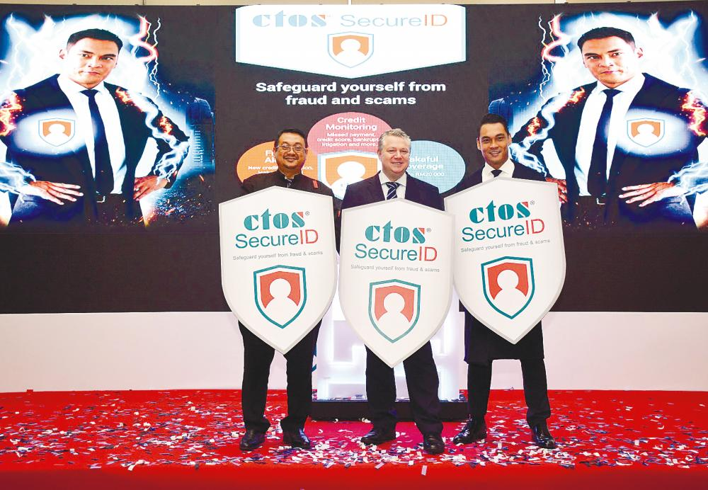 From left: Cybersecurity Malaysia CEO Datuk Amirudin Abdul Wahab, Martin and film & TV star Hisyam Hamid at the launch of CTOS SecureID.