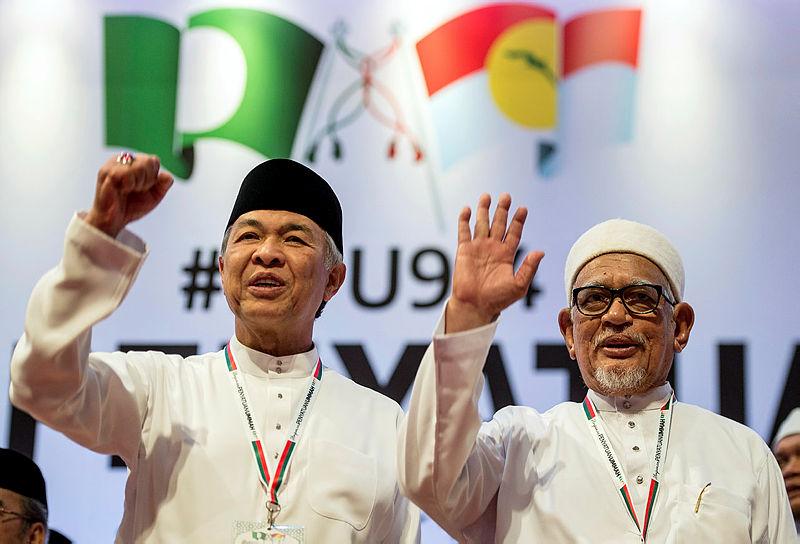 Umno president Datuk Seri Dr Ahmad Zahid Hamidi (L and PAS president Datuk Seri Abdul Hadi Awang at the PWTC, on Sept 14, 2019. — Bernama