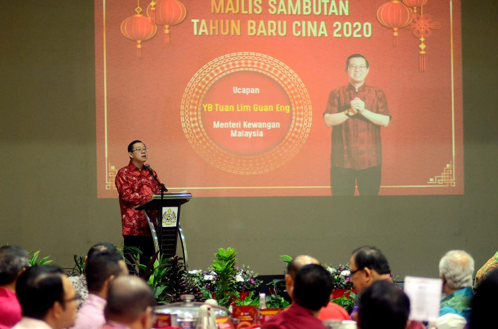 Finance Minister Lim Guan Eng gives a speech at the Penang Royal Malaysian Customs Department's 2020 Chinese New Year Open House celebration in Butterworth today. - Bernama