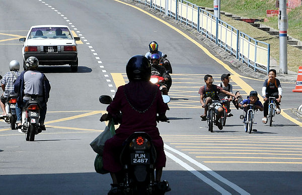 """Filepix taken on Mar 22 shows a group of teenagers performing """"mat lajak"""" stunts on their bicycles."""